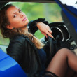 Young woman driving a car — Stock Photo #12592590