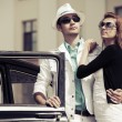 Stock Photo: Young couple with a retro car