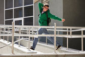 Young student against a university building — Stock Photo