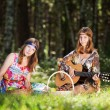 Hippie girls with a fruit basket — Stock Photo