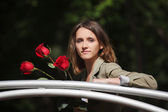 Young woman with a roses — Fotografia Stock