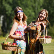 Young girls with a fruit basket — Stock Photo