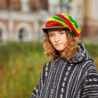 Young rastafarian woman on a city street — Stock Photo