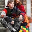 Young hippie couple on the steps — Stock Photo