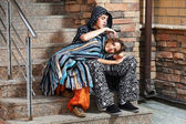 Young hippie couple sitting on the steps — Stock Photo