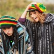 Young rastafarian couple in a city park — Stock Photo