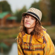 Young rastafarian woman in autumn park — Foto de Stock