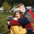 Happy young couple in autumn park — Stock Photo