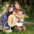 Hippie girls with a guitar outdoor — Stock Photo #15422349
