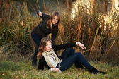 Young girls in an autumn park — Stock Photo