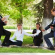 Stock Photo: Young business in a city park
