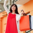 Happy shopper with a phone — Stock Photo
