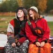 Young hippie couple in autumn park — Stock Photo