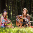Hippie girls with a guitar outdoor — Stock Photo