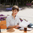 Young businesswoman at a sidewalk cafe — Stock Photo