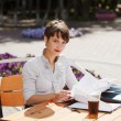 Young businesswoman at a sidewalk cafe — Foto de Stock