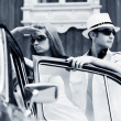 Young couple with a retro car — Stock Photo #18438267