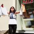 Young woman with shopping bags - Lizenzfreies Foto