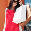 Stock Photo: Young woman with shopping bags