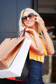 Happy shopper on the phone — Stock Photo