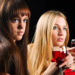 Two young women in a night bar — Stock Photo #18494719