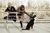 Two young women with a stray dog — Stock Photo