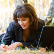 Young businesswoman with laptop — Stock Photo