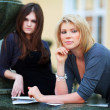 Two young female students on campus — Stock Photo