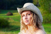 Beautiful young woman on nature — Stock Photo