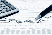 Financial graphs and charts analysis — Stock Photo