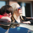 Young couple in a car. - Stock Photo