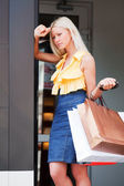 Young woman with shopping bags. — Stock Photo
