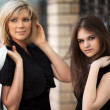 Two young women walking on a city street — Stock Photo #21698757