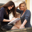 Two young female students on campus — Stock Photo #21698759