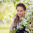 Beautiful woman in a spring garden — Stock Photo #22791118