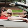 Young couple in a car. — Stock Photo