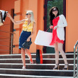 Two young women with shopping bags — Stock Photo #22791276