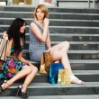 Two young women with shopping bags. — Lizenzfreies Foto