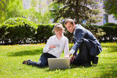 Young business with laptop — Stock Photo