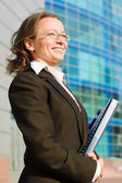 Happy businesswoman with a folder — Stock Photo