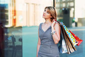 Young woman with shopping bags. — Stockfoto