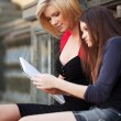 Two young female students on campus — Stock Photo #23526759