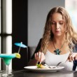 Stock Photo: Beautiful young womdining at restaurant