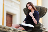 Young female student on campus — Stockfoto