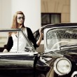 Young woman with a retro car. — Stock Photo