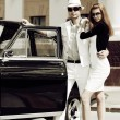 Young couple with a retro car. — Stock Photo