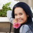 Stock Photo: Happy beautiful woman with a flower