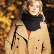 Blond woman in autumn forest — Stock Photo