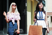 Two happy young women shopping — Stock Photo