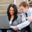Young couple working on laptop — Stock Photo